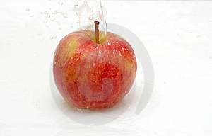 Water Splash On An Apple. Stock Image - Image: 8733111