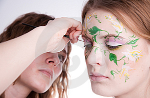 An Artist Making A Picture On The Face Of Her Model Stock Photography - Image: 8747472