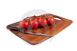 Tomatoes And Knife On Cutting Board Stock Images - Image: 8761324