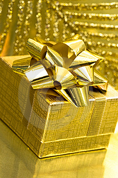 Gift Box On Golden Background Royalty Free Stock Photos - Image: 8761768
