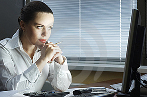 Beautiful Girl In The Evening Sits At Office Royalty Free Stock Image - Image: 8765936