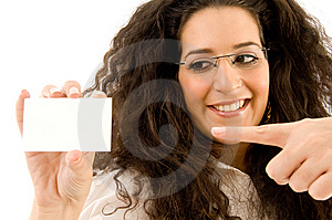 Professional Woman Pointing At Business Card Royalty Free Stock Photography - Image: 8766757