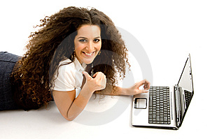 Woman Showing Thumbs Up And Working On Laptop Stock Images - Image: 8767234