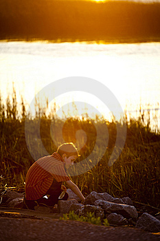 Little Boy Exploring At Sunset Stock Photo - Image: 8775670