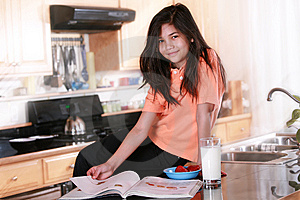 Child Sitting On Countertop Holding Glass Of Milk Stock Images - Image: 8778634