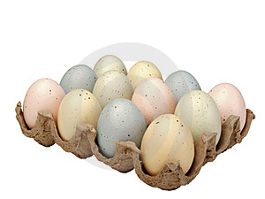Pastel eggs in carton Stock Image