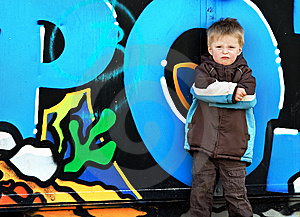 Boy Against Graffiti Wall. Royalty Free Stock Images - Image: 8784459