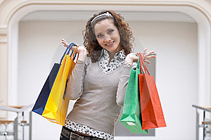 Young Girl With Colored Bags Royalty Free Stock Photo - Image: 8787415