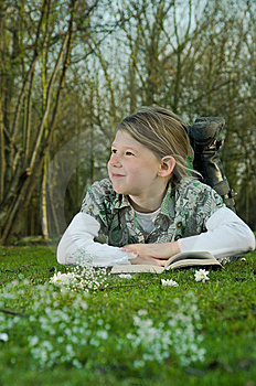 Girl Reading Book On Grass Royalty Free Stock Photography - Image: 8797507
