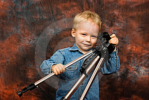 Child Playing With Tripod Stock Image - Image: 8804641