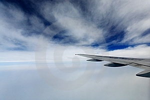 White Fluffy Clouds In The Blue Sky Royalty Free Stock Photo - Image: 8806795