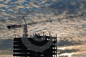 The Elevating Crane On Ripped Clouds Background Stock Image - Image: 8809901