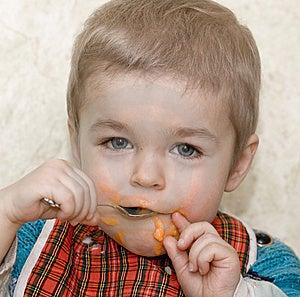 Cute Little Boy Eating Squash Stock Image - Image: 8810581