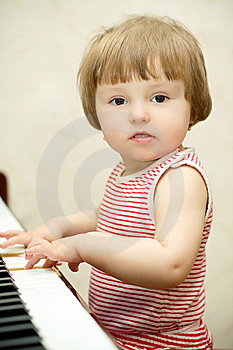 Little Girl Plays Piano Stock Images - Image: 8812054