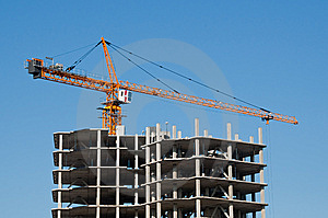 The Elevating Crane On Clear Blue Sky Background Stock Photo - Image: 8847180