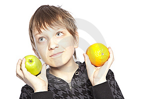 Boy Holding Apple And Orange Stock Image - Image: 8848411