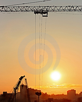 Sunrise In The City With Cranes Silhouettes Stock Photos - Image: 8850643