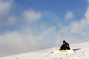 Man With Snowboard Sitting On Slope Royalty Free Stock Image - Image: 8850676