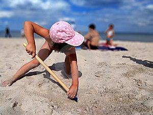 Girl Shoveling Sand Stock Photos - Image: 8860153