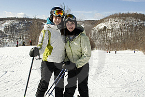 Two Sisters Happy To Be On Ski Slopes Royalty Free Stock Photography - Image: 8877457