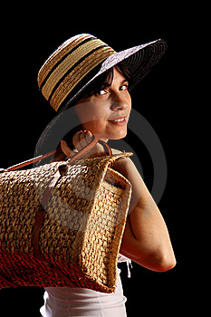 Young Woman With Straw Hat And Bag Royalty Free Stock Image - Image: 8879806