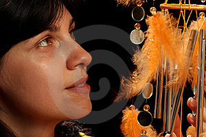 Young Brunette And Wind Chime Stock Image - Image: 8880431