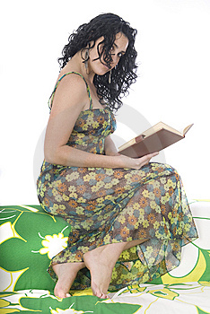 Woman Reading A Book Sitting On An Armchair Stock Photo - Image: 8885130