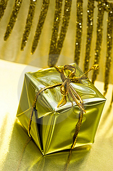 Gift Box On Golden Background Royalty Free Stock Photo - Image: 8888335