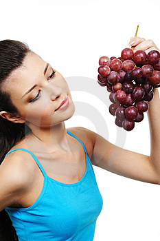 Woman Holding A Bunch Of Grapes Stock Image - Image: 8895821