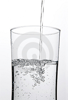 Pouring a Glass of water Stock Images