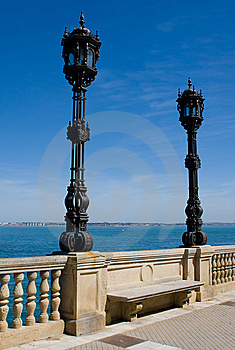 Pair Of Wrought Iron Lights Agaist Blue Sky Royalty Free Stock Photos - Image: 8902508