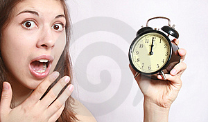 The Girl And An Alarm Clock. Stock Photo - Image: 8923390