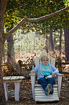 Woman On Outdoor Furniture Royalty Free Stock Photography - Image: 8926137