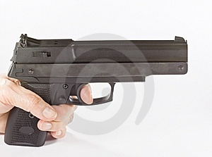 Pistol In Hand On White Background Royalty Free Stock Images - Image: 8932459