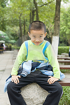 A Kid Sit Beside Tree Stock Photo - Image: 8940560