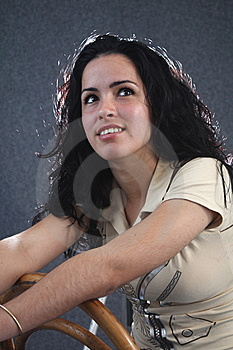 Pretty Girl Looking Up And Sitting On A Chair Stock Photos - Image: 8944773
