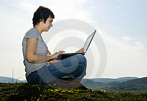Young casual woman working on laptop Stock Photos