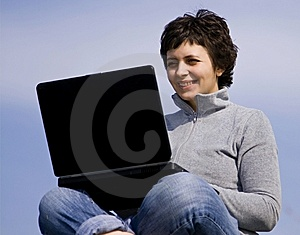 Young casual woman working on laptop