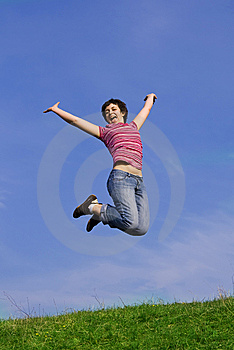 Young happy woman jumping high