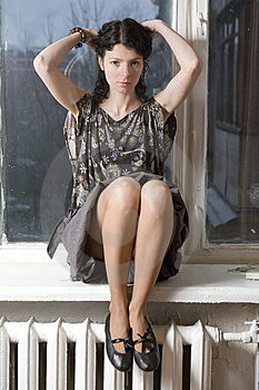 Serious Woman Sitting On Windowsill. Royalty Free Stock Photos - Image: 8960478