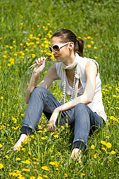 Young Woman In Nature Smelling A Flower Royalty Free Stock Images - Image: 8964399