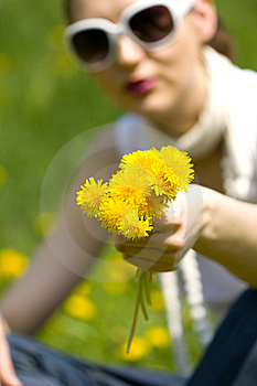 Young Woman In Nature Offering Flowers Royalty Free Stock Image - Image: 8964696