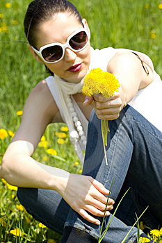 Young Woman In Nature Offering Flowers Royalty Free Stock Images - Image: 8964749