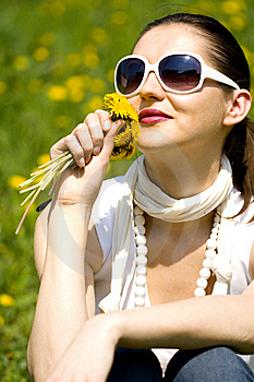 Young Woman In Nature Smelling  Flowers Royalty Free Stock Photo - Image: 8965065