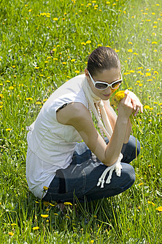 Young Woman Relaxing In Nature Holding Flowers Royalty Free Stock Photos - Image: 8965458