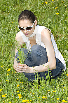 Young Woman In Nature Holding Grass Stock Images - Image: 8965744