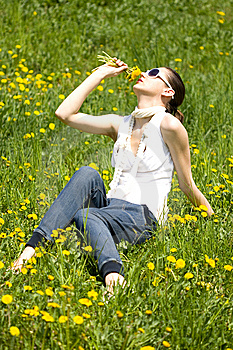 Young Woman In Nature Smelling Flowers Royalty Free Stock Photo - Image: 8966725
