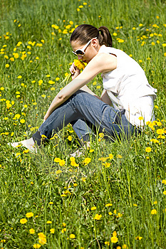 Young Woman In Nature Smelling Flowers Royalty Free Stock Image - Image: 8966786