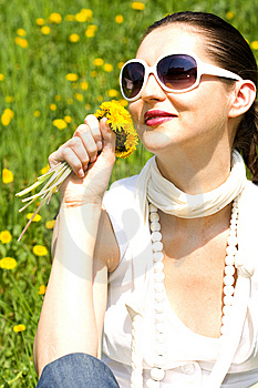 Young Woman In Nature Smelling Flowers Royalty Free Stock Image - Image: 8966896
