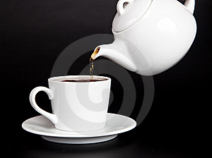 Pour Tea From The Teapot Into The Cup Stock Photography - Image: 8970462